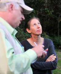 Miller explains to a newspaper reporter that bats, fish and aquatic macroinvertebrates are dependent on the habitat characteristics of the stream and the landscape.