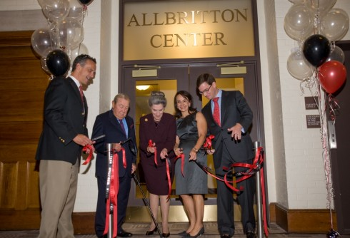 Wesleyan President Michael Roth '78, WHO, WHO, Elena Allbritton '93 and Robert Allbritton '92 take part in a Allbritton Center ribbon-cutting ceremony Oct. 2. The U.S. Green Building Council awarded the Allbritton Center renovation its highly-prized Gold LEED Certification. (Photo by Bill Burkhart)