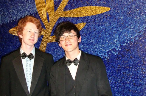Nathaniel Draper '12 and his friend Matt Firpo (NYU '12) stand in front of Festival de Cannes emblem in the Grand Lumiere Theater. Draper was an intern at the Festival de Cannes.
