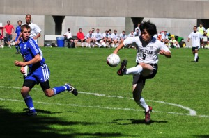 Keisuke Yamashita '10 goes for a goal against Colby College.