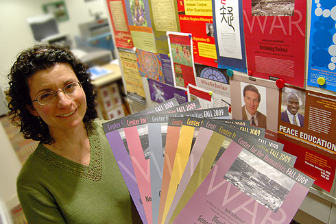 Jennifer Platt, printing specialist for Information Technology Services, shows samples of posters she printed in the ITS Print Shop located in Usdan University Center.