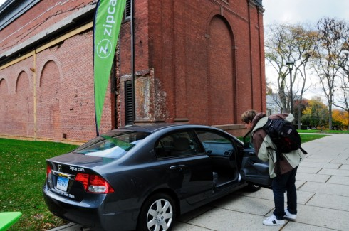Charlie Kurose '10 checks out one of the two Zipcars that will be used by Wesleyan students. To sign up for Zipcar use, students over the age of 18 need a valid driver's license and a credit card.