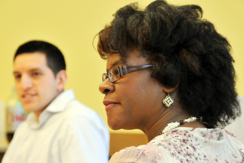 From left, Rommel Guadalupe, assistant director of institutional research, and Maggie Taylor, Public Safety officer, listen to their peers during the Nov. 16 meeting of the Administrators and Faculty of Color Alliance (AFCA). AFCA, a volunteer organization comprised primarily of administrators, faculty, and staff of African, Latino, Native American, and Asian descent, provides fellowship and support to all students, faculty, and staff on campus paying particular attention to the needs of the people of color in the community.