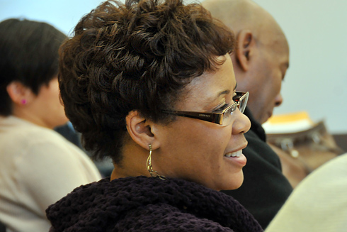 AFCA member Tracey Stanley, administrative assistant in the Registrar's Office, listens during the recent AFCA meeting. In the background, at right, is Ronnie Bowman, journeyman electrician.