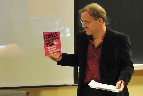 Joel Pfister, the Kenan Professor of the Humanities and chair of the English Department, holds a copy of Levy's book, <em>Female Chauvinist Pigs</em>. Pfister introduced the speakers and moderated the event.