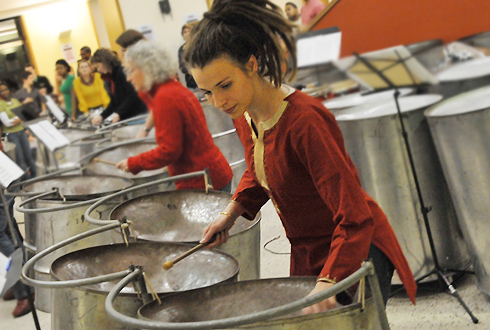 "Brandi Cahill, assistant director of the Office of University Events, performs on steel drums during the ""Pannin' the Night Away: Steel Band Live"" concert Dec. 13 in Usdan University Center. The Wesleyan staff steel band opened."