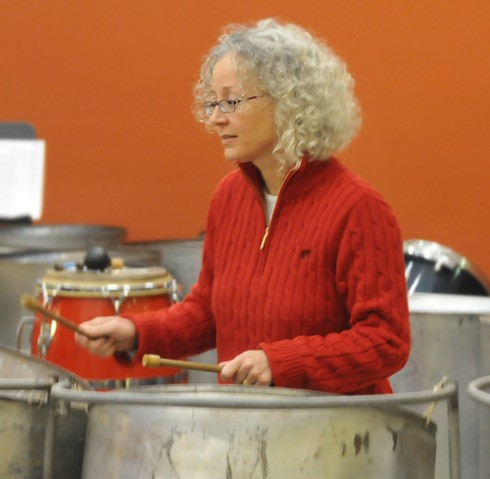 Cheryl-Ann Hagner, director of the Office of University Events and Scheduling, performs on a steel drum with the staff band.