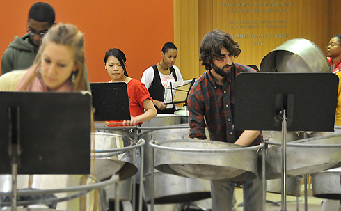 The steel pan (or steel drum) is composed of from one to nine 55-gallon steel barrel drums, suspended with stands.