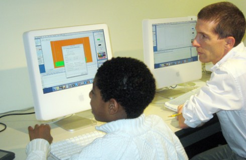 At right, Shawn Hill, desktop support specialist for science and math, taught students photo manipulation software during the event.