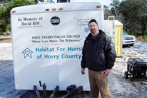 Jeff Gilarde, director of scientific imaging in the Biology Department,  spent his holiday vacation volunteering with the Habitat for Humanity of Horry County, near Myrtle Beach, S.C. Gilarde is pictured here near the tool trailer on Dec. 30, where the temperature was 38 degrees.