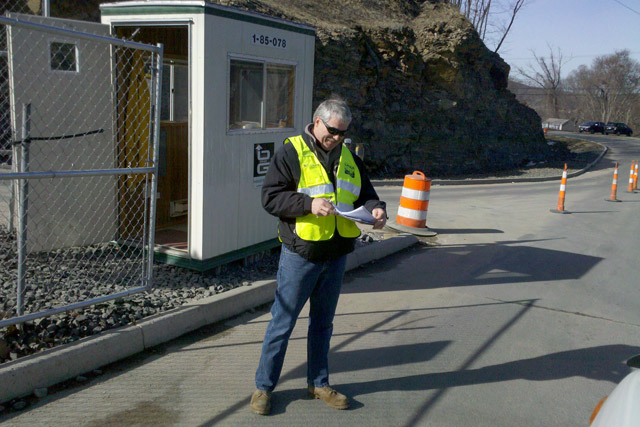 Campus Community Emergency Response Team member Bill Nelligan records the names of personnel accessing the Kleen Energy power plant in Middletown following the deadly explosion Feb. 7. The C-CERT group volunteered almost 100 hours of time.