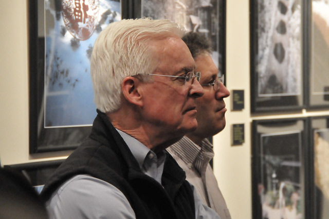 From left, John Driscoll, alumni director, and Paul DiSanto, director of leadership giving, listen to Dowdey speak about his photographs of the garden. For 15 years, the Freeman Family Garden and Tatami Room have lent the homely, friendly air of a Japanese home to the Center for East Asian Studies.