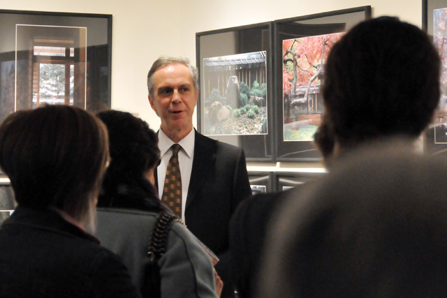 "Patrick Dowdey, curator of the Freeman Center for East Asian Studies, adjunct professor of East Asian Studies and anthropology, welcomed guests to the opening of ""Shoyoan: Celebrating the Freeman Family Garden"" March 31 in the Freeman Gallery. The exhibition features photographs, poetry and video that celebrate time and season in Wesleyan's Freeman Family Garden and Tatami Room."