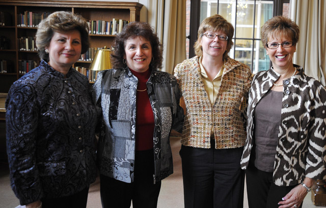Pat Tully, third from left, hosted a reception March 4 in the Smith Reading Room to honor three long-time library staff members who are retiring from Wesleyan this year. The librarians are, from left, Roberta Raczka, Science Library assistant in circulation; Linda Marquis, Science Library assistant in access services and at far right, Ann Marino, Olin Library administrative assistant and facilities coordinator.