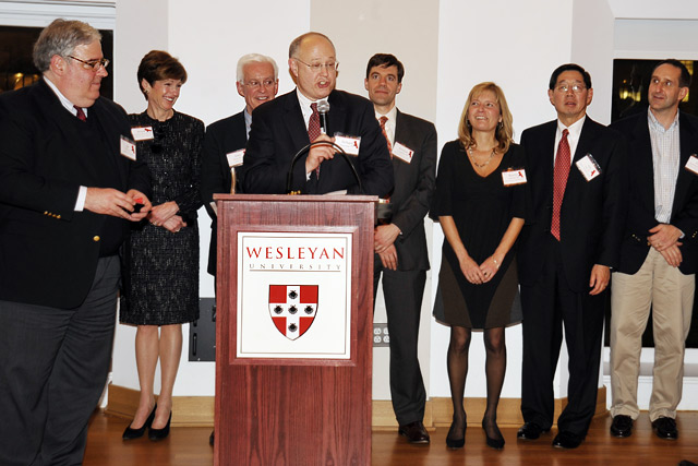 Richard Swanson '77, chair of the Wesleyan Fund, speaks during the 2010 Volunteer Weekend dinner and reception Feb. 26 in Beckham Hall.  Several alumni and parent volunteers were honored for their volunteer service. Also pictured, from left, are Joe Fins '82; Moira McNamara James '78, P'10; John Driscoll '62; Brendan Coughlin '95; Bonnie LePard '82; Leo Au '71 and Dave Bartholomew '81.