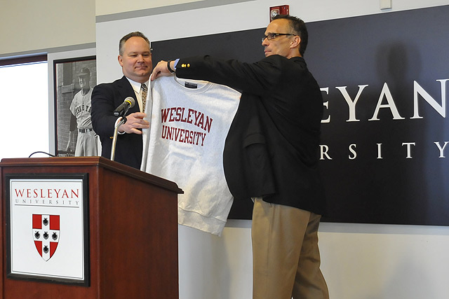 Wesleyan President Michael Roth, right, introduced new football head coach Mike Whalen '83, left, to the Wesleyan community during a ceremony March 8 in the Freeman Athletic Center. Whalen, the 2006 NESCAC Coach of the year, comes to Wesleyan from Williams College, where he had been the head coach since 2004. Whalen also will serve as Wesleyan's assistant athletic director. 