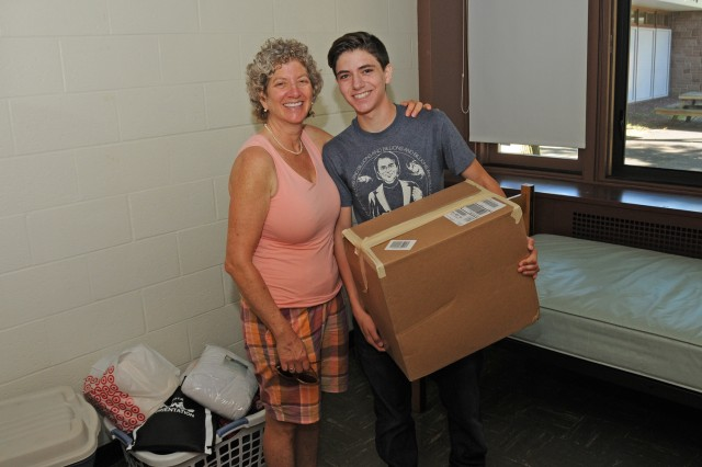 "Leo Grossman '16 of Oakland, Calif. unpacked his belongings with help from his mother, Jill. Leo is living in the Butterfield Residences. ""I brought a lot of nicknacks so it feels like home,"" he says."