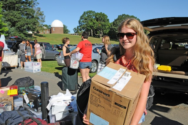 "Savannah Benis '16 of San Diego, Calif. unloads her belongings during New Student Arrival Day Aug. 29. Benis, who is planning to major in film studies, is living in Clark Hall. ""I'm so excited, but nervous,"" she says."