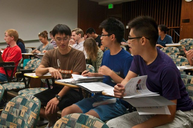 Classmates Lee Chen '15, Ryan Graff '14 and David Mai '15 work on an assignment together.