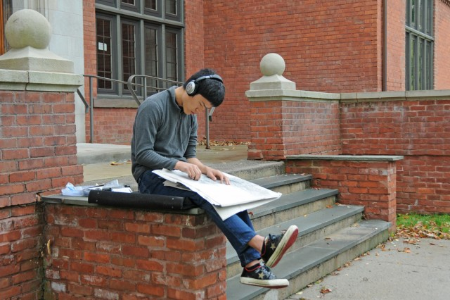 Kotaro Aoki '16 makes a sketch outside 200 Church on Sept. 26. Aoki is enrolled in Drawing I this semester.