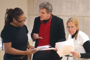 Ron Jenkins, center, rehearses with former inmates Saundra Duncan and Lynda Gardner. (Photo by Steve Miller)