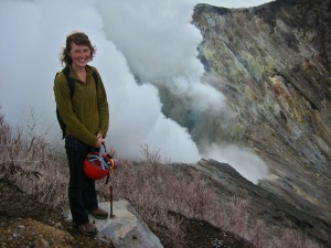 Audrey Haynes '12 stands on the rim of the Turrialba volcano in Costa Rica. When she tested samples of human hair from 53 residents in the area, she discovered high levels of mercury in more than half of the samples.