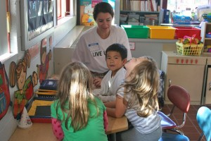 Olivia Tempest '13 works with children at Farm Hill Elementary School in Middletown.