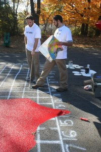 Residential Life area coordinators Brian Nangle and Daniel LaBonte paint a map of the United States on the school's playground.
