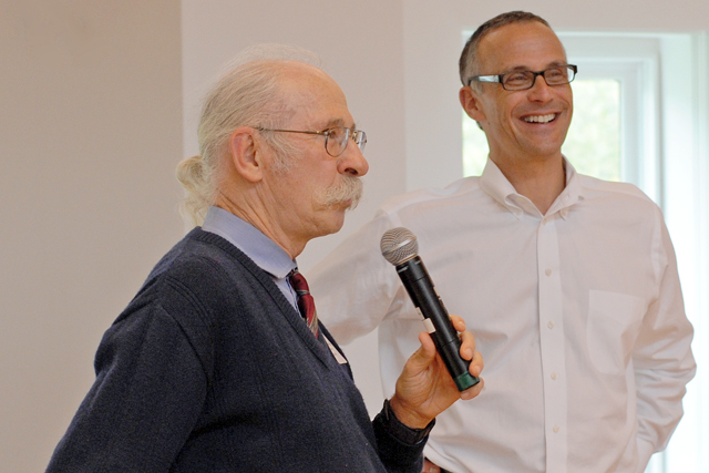 Erhard Konerding, documents librarian, speaks about his Olin Library memories during the annual Employee Service Luncheon Oct. 9 in Beckham Hall. Konderding is celebrating his 40th year at Wesleyan. Pictured at right is Wesleyan President Michael Roth.