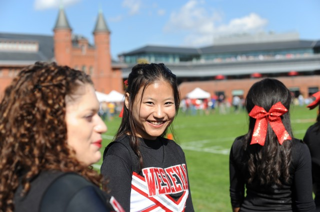 In center, Isabella Sihui Zhu '14 cheered on the Cardinals during the Homecoming football game Oct. 20. The Cardinals lost to Amherst 17-9.