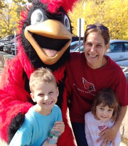 Kira (Markiewicz) Fabrizio '97 and her children, Vance and Maeve Fabrizio, meet the Wesleyan Cardinal.
