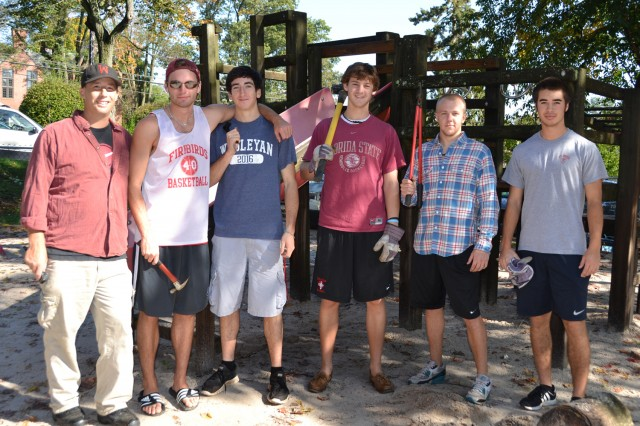 A rotating crew made up of the Wesleyan baseball team helped remove a 23-year-old wooden playscape at the Neighborhood Preschool Oct. 5. Team members arriving for the earliest shift are, from left, Coach Mark Woodworth '94; Jimmy Hill '14 of Glastonbury, Conn.; Jordan Farber '16, of  Livingston, N.J.; Jeff Blout '14 of Duxbury, Mass.; Chris Law '14 of Dover, Mass.; and Kai Kirk '16 of San Jose, Calif.