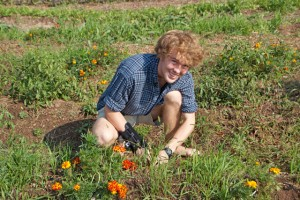 Coady Johnson '15 harvests produce at Long Lane Farm.
