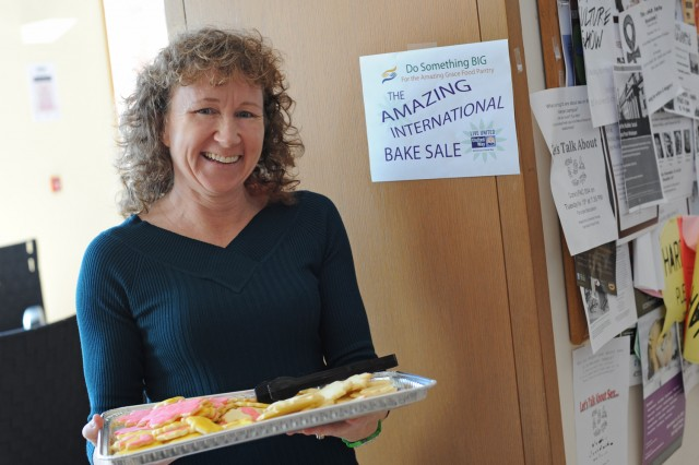 Sherri Condon, accounting specialist in Auxiliary Operations and Campus Services, displays a tray of Canadian sugar cookies during the International Bake Sale Nov. 14 in Usdan University Center. Through baked goods and pumpkin pie sales, Wesleyan raised $900 for the Amazing Grace Food Pantry in Middletown.
