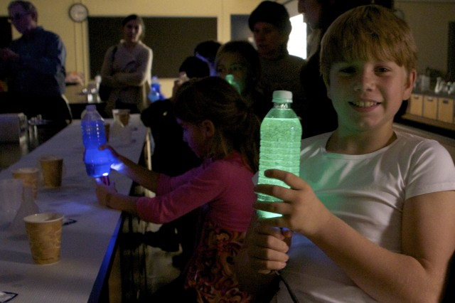 Young scientist Noel shows off a lava lamp he made during Science Saturday.