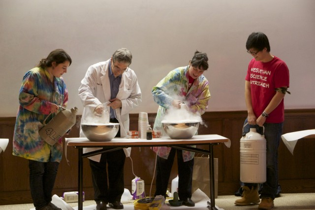 Eliza Forman '13, Andrea Roberts, visiting assistant professor of chemistry, David Westmoreland, associate professor of chemistry, and Henry Chang '14 work together to make ice cream using liquid nitrogen to wrap up Science Day.