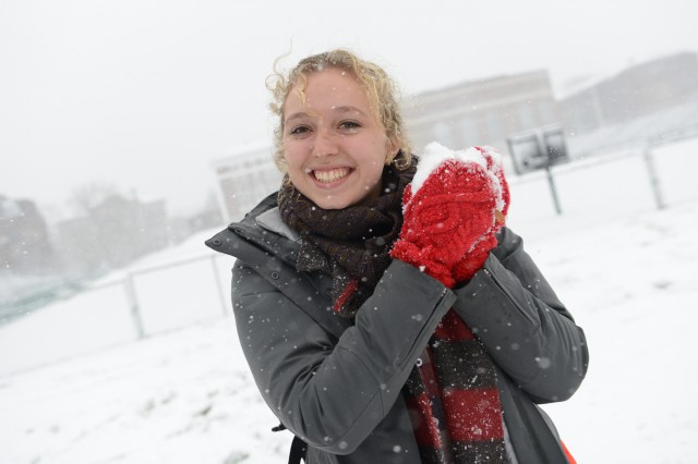 Rebecca Brand '16 makes a snowball.