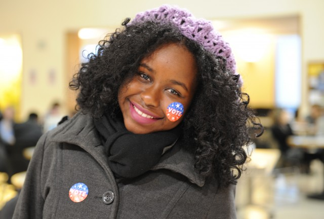 "Ibironke Otusile '15 dons two ""vote"" stickers during Election Day Nov. 6."