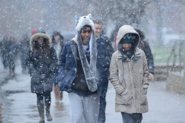 Donning a cozy husky hat, Aarit Ahuja '16 and his friend Purnima Kumar '16 walk to class.
