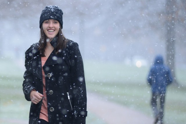 Jessica Seidman '16 enjoys the light snowfall Nov. 27 as she crosses College Row.