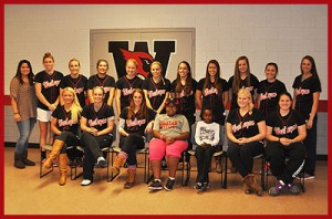The Wesleyan softball team and Stephanie Lubogo.