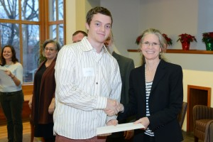 Sociology major Evan Okun accepts his Phi Beta Kappa papers from Class Dean Louise Brown, PBK chapter secretary and marshall. Okun teaches a class at the juvenile detention in Middletown, which examines literary technique and societal inequality through rap songs.