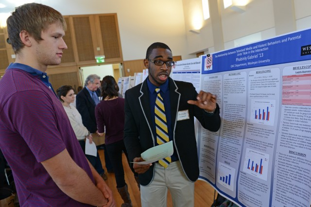 "Phabinly ""Phabs"" Gabriel '13 presented his research on ""The Relationship between Televised Media and Violent Behaviors."""