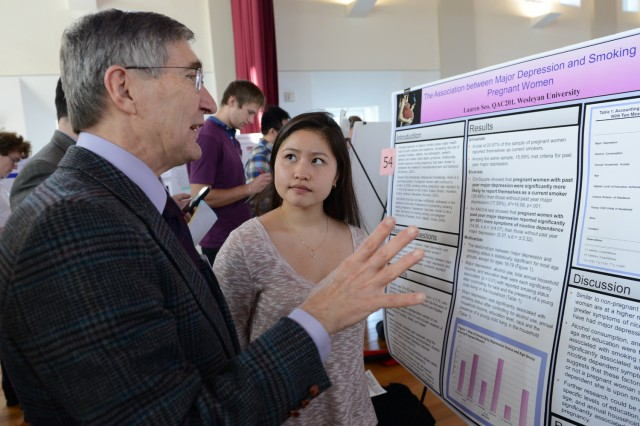 "Lauren Seo '14 speaks to a guest judge about her research on ""The Association between Major Depression and Smoking in Pregnant Women."""