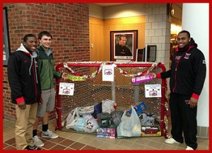 "Wesleyan student-athletes gathered gifts for local school children at ""Stuff the Nets"" Dec. 8."