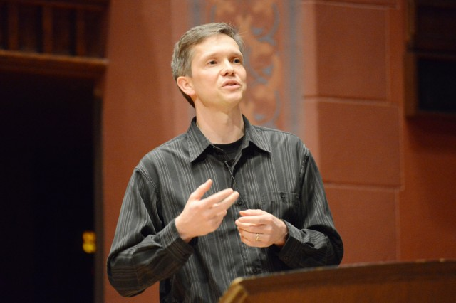 "Greg Voth, associate professor of physics, spoke on ""The Paradox of Modern Physics."" Voth said, ""While these theories are amazingly successful, we also know that they're wrong. We are constantly trying to find deviations."""