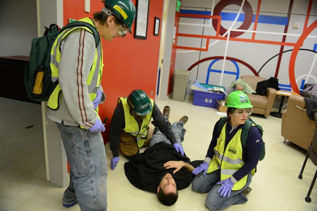 C-CERT trainees practice triage in Usdan's activities room.