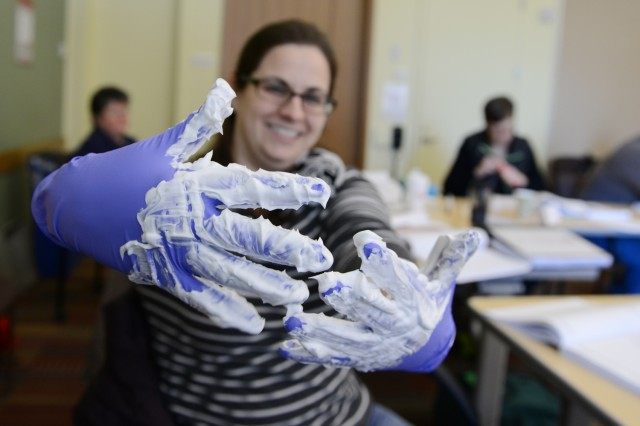 If this shaving cream was a contaminate, how can you remove your medical gloves without getting the contaminate on your own skin? C-CERT trainee Gretchen Streiff, assistant director of student activities and leadership development, gives it a try.
