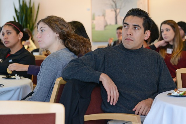 At left, Raquel Martinez, a graduate student in astronomy; Madeleine Manheim, a BA/MA graduate student in astronomy; and Christopher Ramos Flores, a graduate student in music, listen to President Roth.