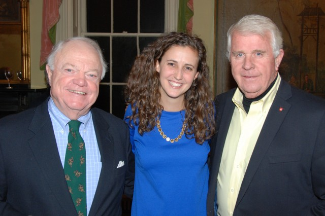 Alexis Sturdy mingles with celebration guests Bud Feeney and John Santa. Santa is chairman of the Sovereign Military Order of Malta Prison Volunteers of Connecticut.
